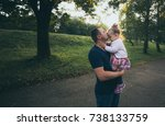 little girl and dad hugging... | Shutterstock . vector #738133759