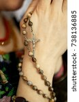 female hands with rosary beads...   Shutterstock . vector #738136885