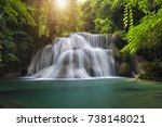 waterfall with deep forrest... | Shutterstock . vector #738148021
