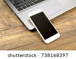 smartphone next to laptop... | Shutterstock . vector #738168397