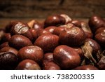 Small photo of Conkers on Wood Planks, Horse Chestnut, Autumn Fall Background Equinox Buckeye Rustic Water Droplets Texture