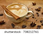 Small photo of Chrismas cup of coffee with latte art and cinnamon and star anis spices