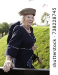 Small photo of Roelofarendsveen, The Netherlands - October 14, 2017: Princess Beatrix, the former queen of the Netherlands, was present at the reopening of the three hundred year old Googermill after a renovation