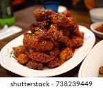 spicy fried chicken  | Shutterstock . vector #738239449