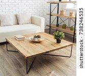 modern wooden table in the loft ... | Shutterstock . vector #738246535