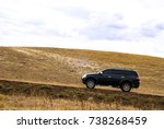 suv on the hill | Shutterstock . vector #738268459
