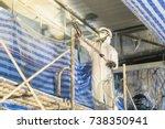 technician spraying foam...   Shutterstock . vector #738350941