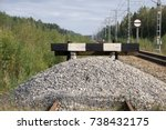 Small photo of wooden buffer stop with red stop sign ending rail tracks concept for limit, limitation restriction boundary, prohibited, end , border