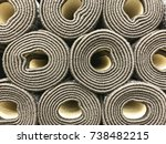 edges of rolled carpets. | Shutterstock . vector #738482215