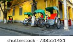 tricycle in the streets of hoi... | Shutterstock . vector #738551431