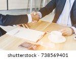 investors reassure businessman... | Shutterstock . vector #738569401