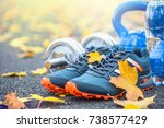 pair of blue sport shoes water... | Shutterstock . vector #738577429