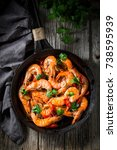 tasty shrimps on pan with... | Shutterstock . vector #738595939