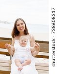 happy and young mother sitting... | Shutterstock . vector #738608317