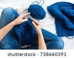 Woman Knitting Blue Sweater....