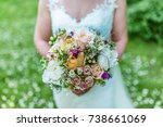bride holding her bridal bouquet | Shutterstock . vector #738661069