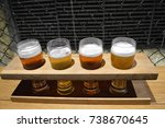 four glasses of beer in a... | Shutterstock . vector #738670645