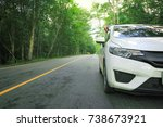 Stock photo front of white car parking on asphalt road 738673921