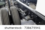 Small photo of Leaf spring and right rear tire of 6 wheel medium duty truck.