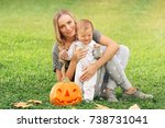 happy mother with little baby... | Shutterstock . vector #738731041