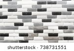 Stock photo black white and gray glass tile backsplash in a kitchen 738731551