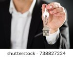 key chain with key in hand of a ...   Shutterstock . vector #738827224