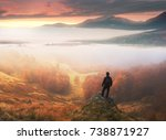 Man Stands On Background Of...