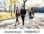 three friends walk on the street | Shutterstock . vector #738884017