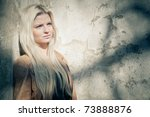 blonde woman leaning on grungy... | Shutterstock . vector #73888876