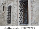windows with bars on the wall... | Shutterstock . vector #738894229