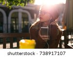 young attractive woman in cozy... | Shutterstock . vector #738917107