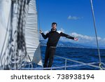 man in black on the sailboard... | Shutterstock . vector #738938194