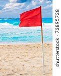 Red Warning Flag In A Beach...