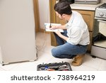 good looking male technician... | Shutterstock . vector #738964219