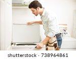 good looking young handyman... | Shutterstock . vector #738964861