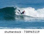 bodyboarder surfing ocean wave... | Shutterstock . vector #738965119