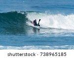bodyboarder surfing ocean wave... | Shutterstock . vector #738965185