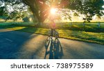 young girl cycling tourist in... | Shutterstock . vector #738975589