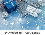 white wooden sledge with blue... | Shutterstock . vector #739013581