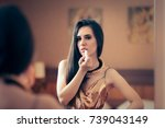 woman applying lipstick getting ...   Shutterstock . vector #739043149