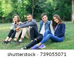 young people sitting on grass...   Shutterstock . vector #739055071