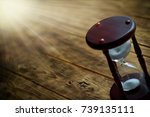 Small photo of Hourglass with sunrays