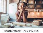 little cute girl is cooking on... | Shutterstock . vector #739147615