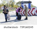 border guard checking bags of... | Shutterstock . vector #739160245