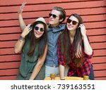 young people posing with penny... | Shutterstock . vector #739163551