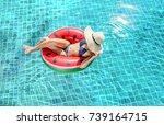 woman bikini swimming pool on...   Shutterstock . vector #739164715