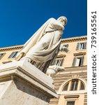Small photo of Allegorical winter statue in Piazza del Popolo. Rome, Italy