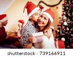 cute little boy holding... | Shutterstock . vector #739166911