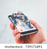 man holding smartphone with...   Shutterstock . vector #739171891