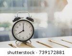 retro alarm clock on wooden... | Shutterstock . vector #739172881